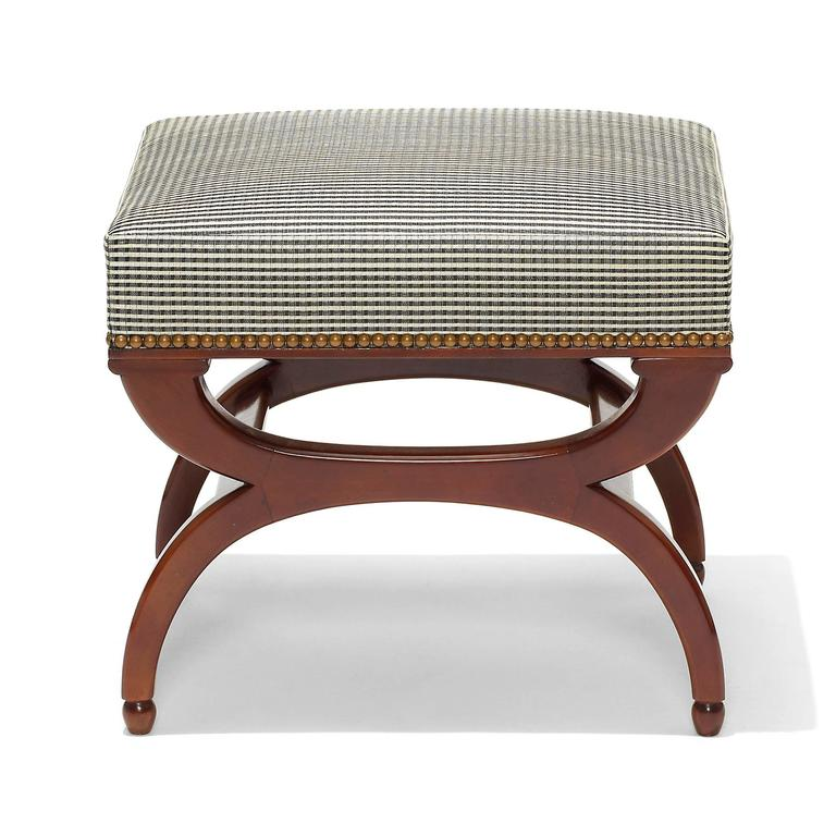 Bench or ottoman by Frits Henningsen (1889-1965), with Curule legs terminating in acorn feet, in solid carved Cuban mahogany, recently reupholstered with ivory and black checkered pattern horsehair fabric, Denmark, 1940s.