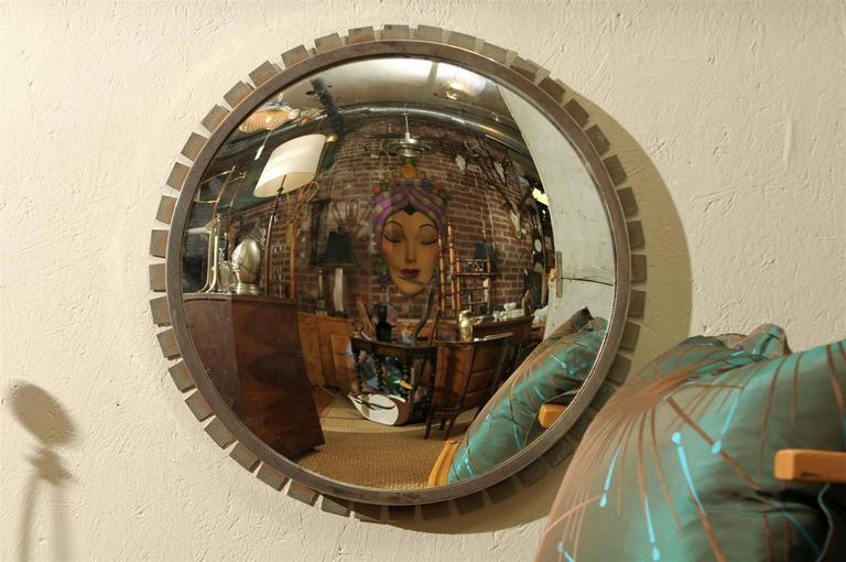 Vintage round convex mirror in an Industrial style minimalistic sunburst steel frame.