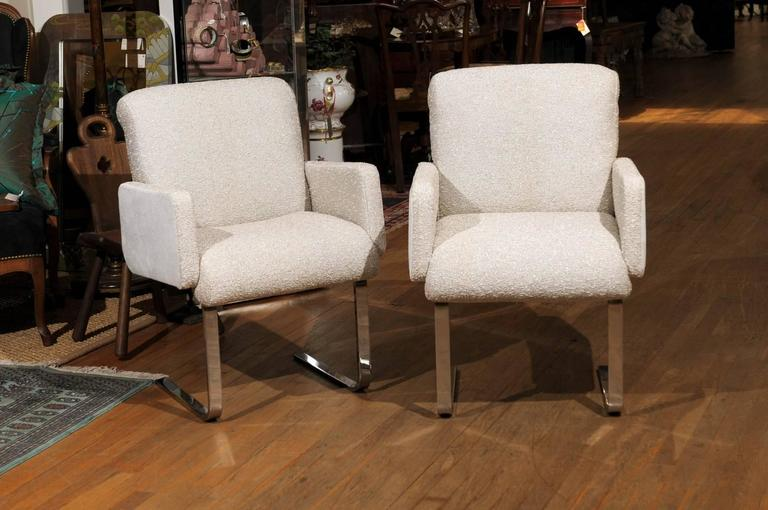 """Pair of Mid-Century Moderncantilevered chrome """"Lugano"""" armchairs by Frank Mariani for pace collection. The chairs are newly reupholstered in a vintage silver tweed on the front and a corresponding silver on the back."""