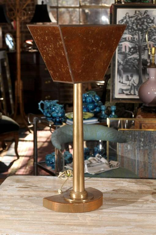 Tall pair of early 20th century Machine Age lamps with amber colored mica uplights, sleek bronze shafts, and mounted to demilune wooden bases.