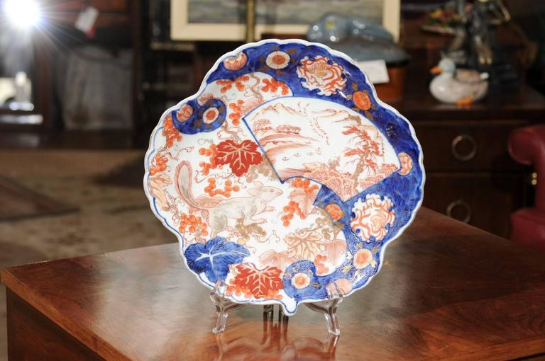 19th Century Japanese export Imari porcelain plate with an unusual scalloped and shell shape and a rare squirrel motif.