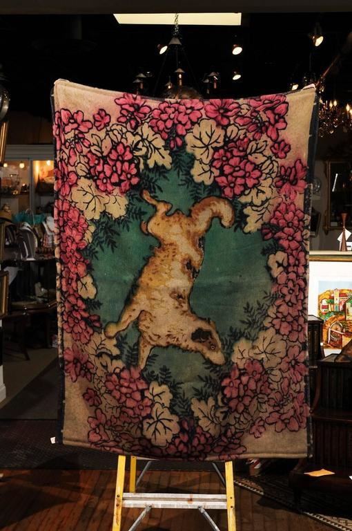 19th century Victorian wool and angora carriage blanket or lap robe. Lovely design with a wreath of flowers and garland surrounding a dog with an eye made of glass. The reverse side is dark brown. Lap robes by Chase and Company were manufactured by