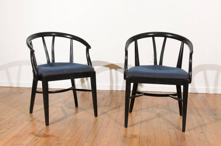 Mid-20th century set of six black lacquer, wishbone style, barrel back dining chairs with upholstered seats.