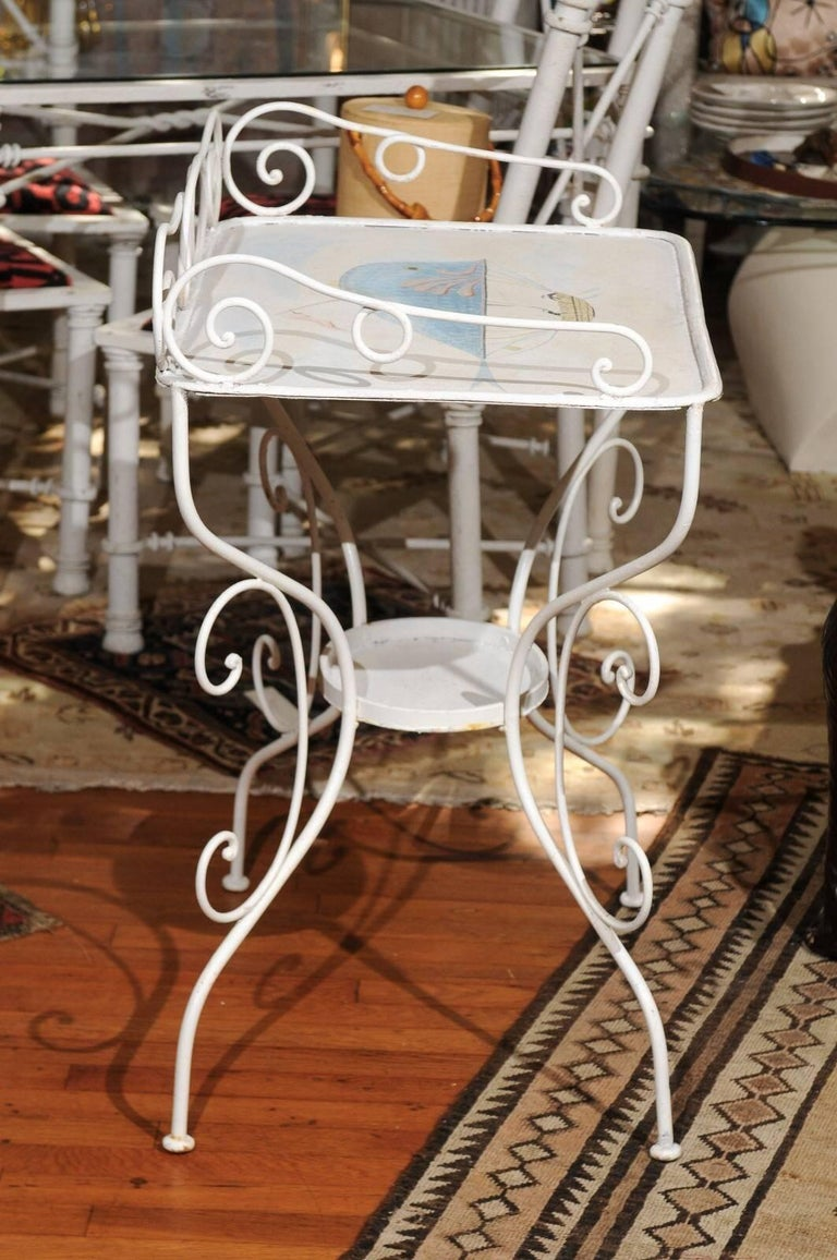 Late 19th Century French wrought iron garden table painted in white with a charming Victorian era steampunk illustration of a whale shaped hot air balloon carrying three sailors in a suspended boat.