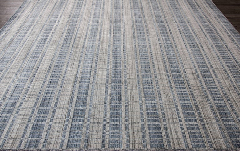 This beautiful 21st century, modern hand-loomed Indian hand-knotted design rug will make your floor look splendid. This collection is made in wool. It's measures are: 8'.2 x 10'. This 21st century modern hand-loomed Indian rug was made in India.