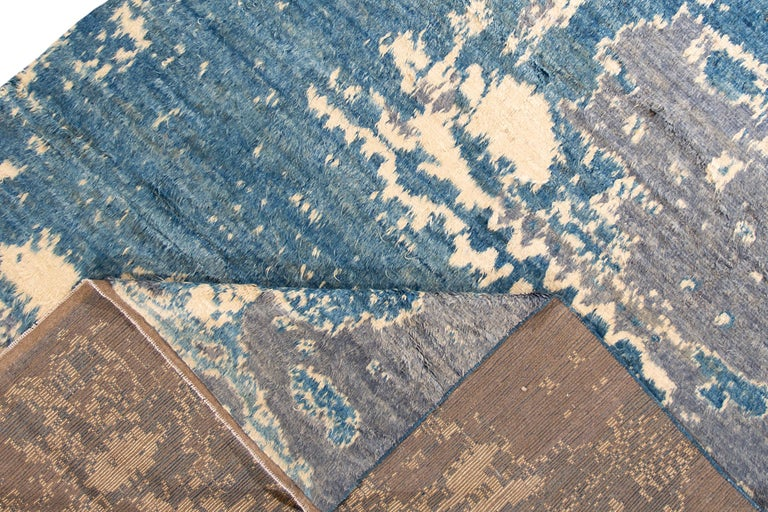 A modern 21st century Moroccan-style Rug with an all-over gray/blue motif. This rug measures at 9'9
