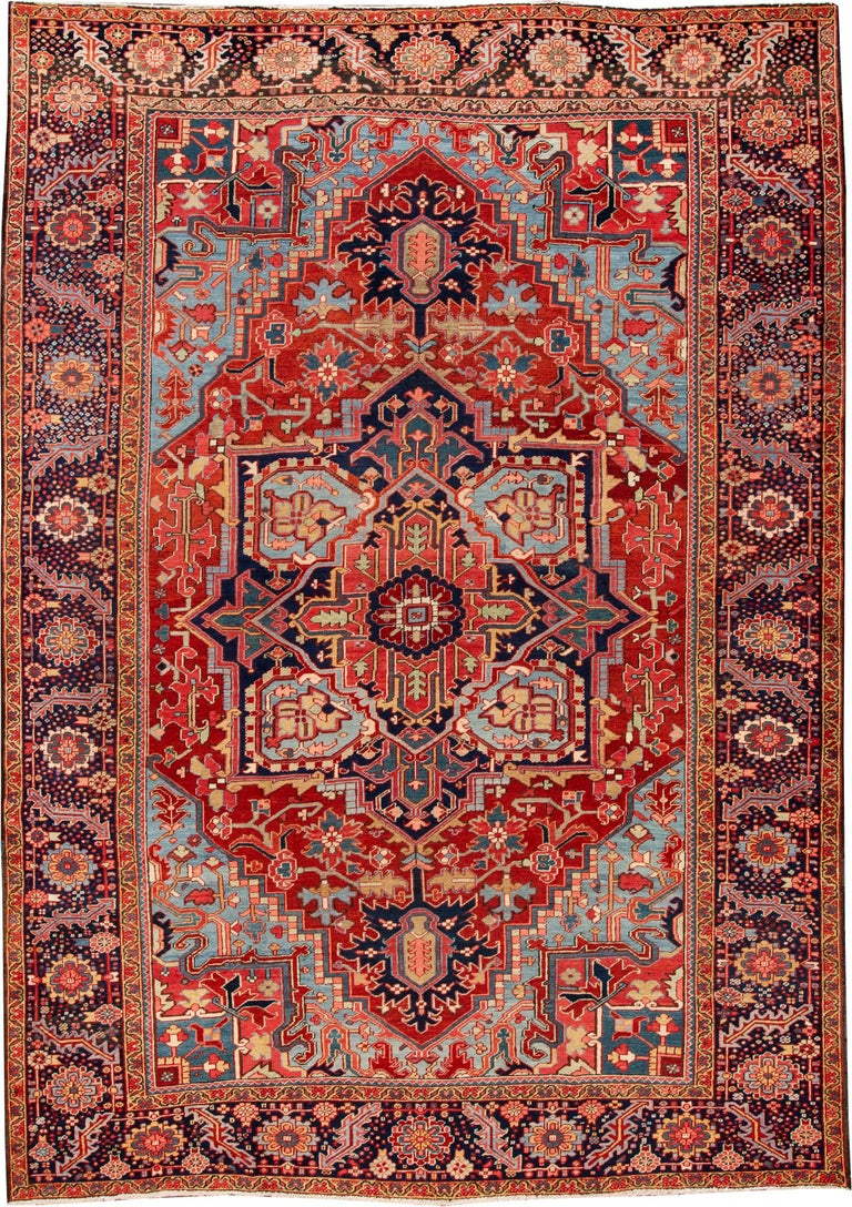 Early 20th Century Antique Rust and Blue Persian Heriz Rug For Sale