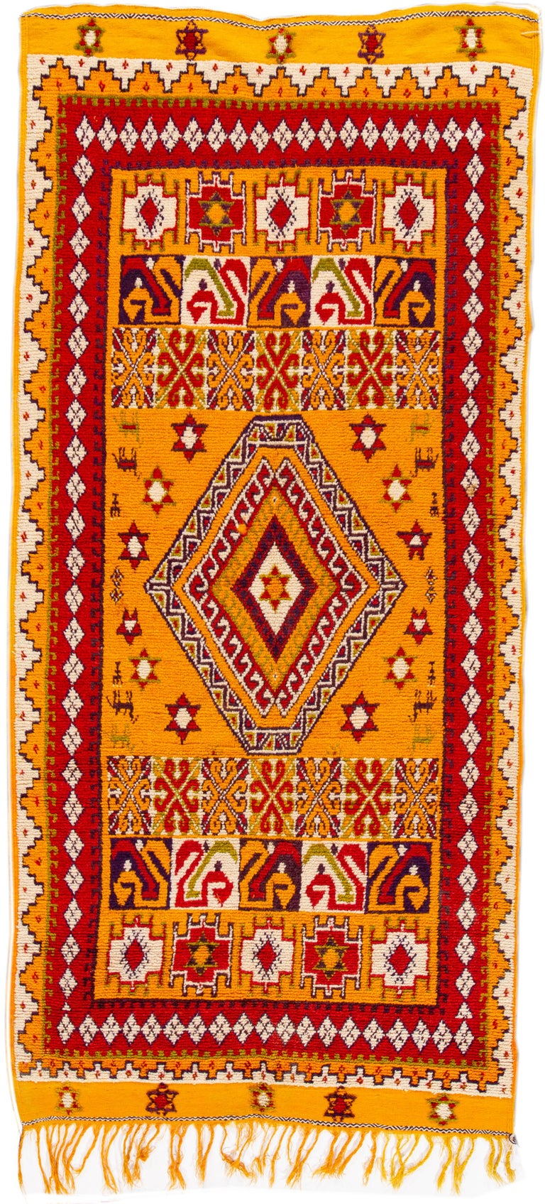 Hand-knotted Moroccan rug with orange and red tribal design. This rug measures approximately 8 feet 9 inches by 13 feet 1 inch.