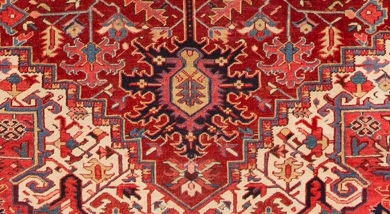 1920s, antique Heriz carpet, red or rust background with geometric design, measures: 9.06 x 12.06.