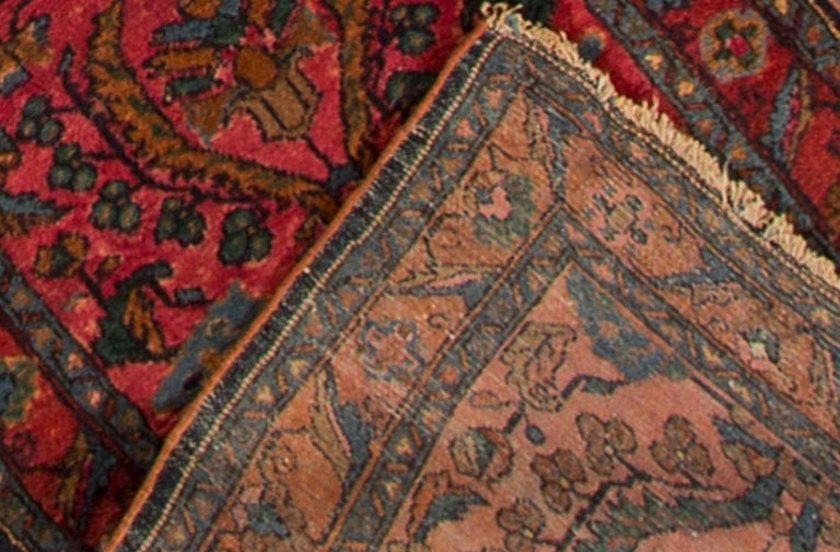 1905 antique Persian Lilihan runner rug. Hand-knotted, 100% wool with a dark red field and all-over floral design in blue. Measures: 2.07 x 16.08.
