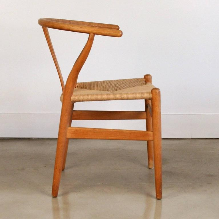 Set of Four Vintage Oak Wishbone Chairs CH24 by Hans Wenger at 1stdibs
