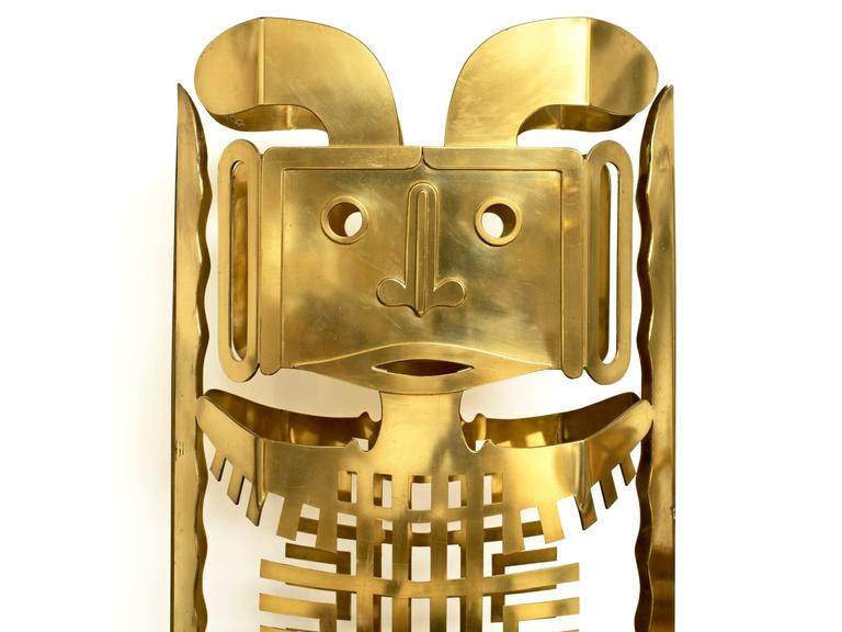 Stunning 6' Mayan totem sculpture in polished brass by renowned sculptor Robert Zeidman (1915-1996). This unique sculpture is double sided with pinned brass hinges and can be used as a screen as well.  When opened it's 42 inches wide.  Zeidman