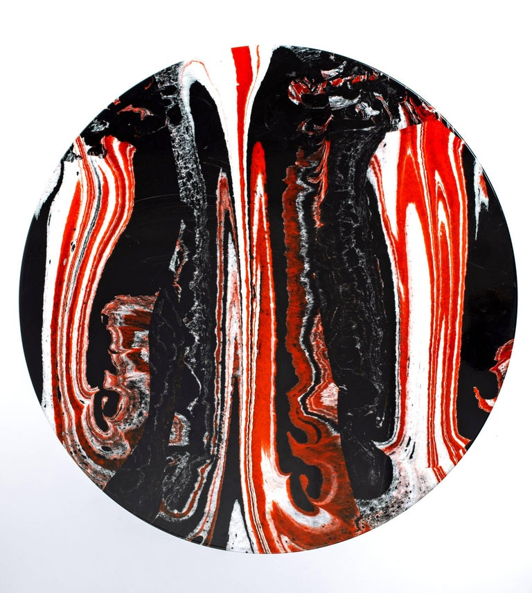 Fabulous bold marble design with a dramatic pattern of red, black and white married to a vintage iron patinated base. Super chic side or end table.  This rare marble is from Israel.