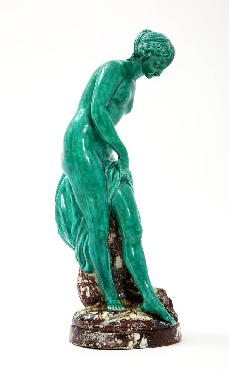Fabulous and Quite Unique French Majolica Sculpture of Diana circa 19th century.  This beautiful nude sculpture with drapery over her leg is a stunning shade of turquoise set against a mottled brown base with seashells and other elaborate details.