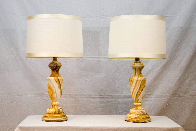 "Nice pair of onyx table lamps in white and various shades of tan as well as grey. The on/off knobs resembles a key. The onyx bases are 19"" high. They are heavy and very stable."