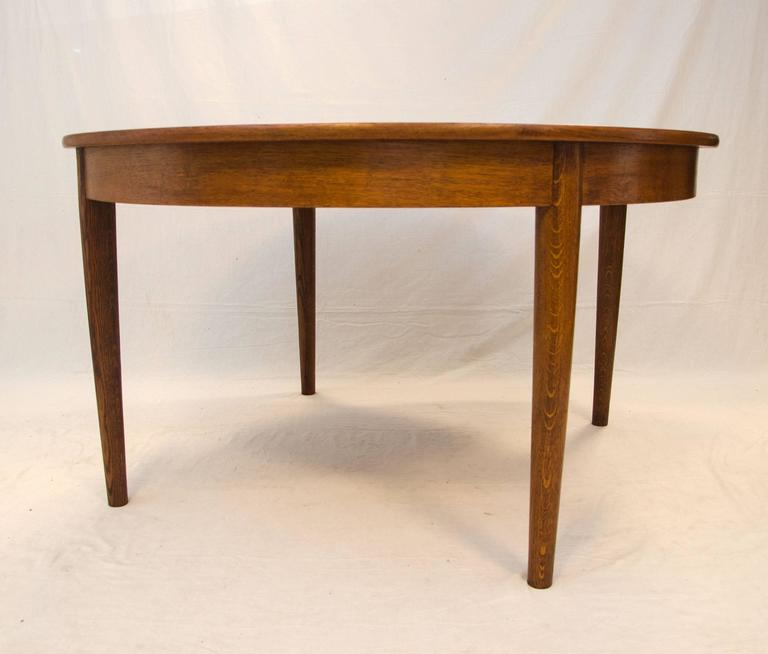 Danish Round Teak Dining Table with Four Skirted Leaves by