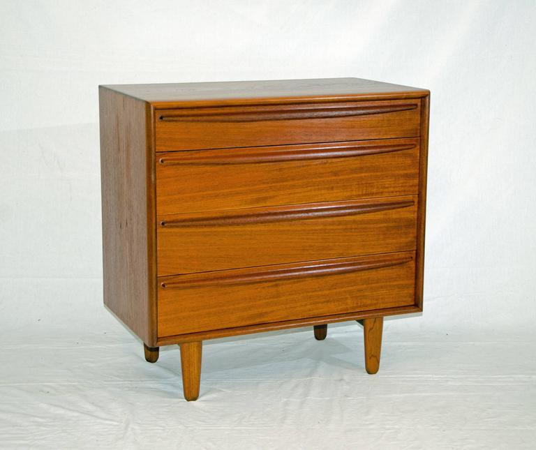 "Nice small four-drawer teak chest perfect for a child's room or hallway. It is a well made small dresser with mahogany drawer bottoms and sides. The top drawer is 3 1/2"" deep and the three lower drawers are 5 3/4"" deep."