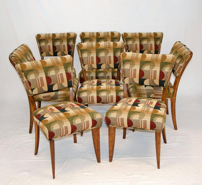 """Nice set of eight dining chairs with upholstered backs and seats. The chair backs are somewhat canted to allow for a comfortable seating position. The front legs are very angular and tapered, they give a """"flat"""" appearance but are about"""