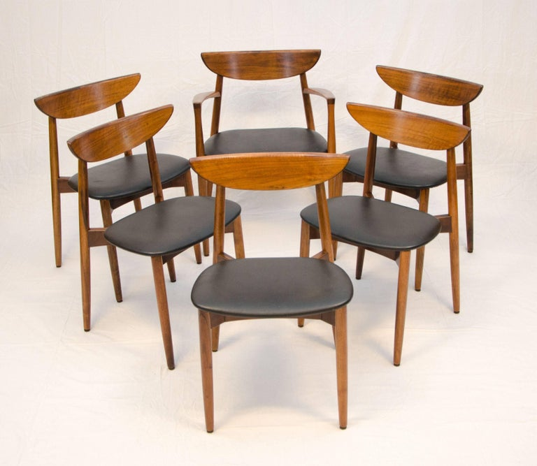 Nice set of six Danish walnut dining chairs designed by Harry Ostergaard and imported my Moreddi. The armchair is slightly larger than the side chairs. Measures: 23