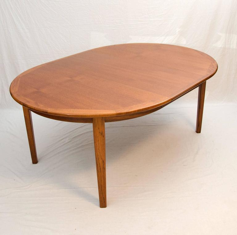 Large danish teak round dining table four skirted leaves for 12 seat round dining table