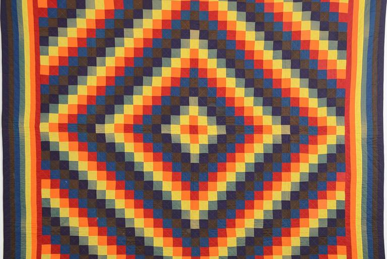 It's difficult to believe, but true, that a quilt with such electric colors is from the 19th century. It is the ultimate version of a Mennonite Trip Around the World quilt. The Joseph's Coat, or rainbow, border beautifully combines seven colors. The