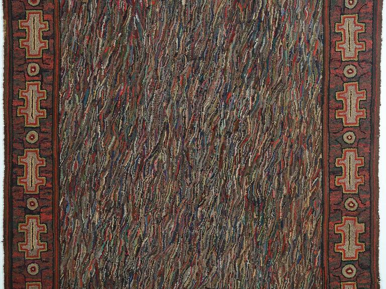 This Hit or Miss hooked rug combines an open center pattern framed by a more structured border. The huge variety of colors makes it adaptable to virtually any environment. The rug measures 70