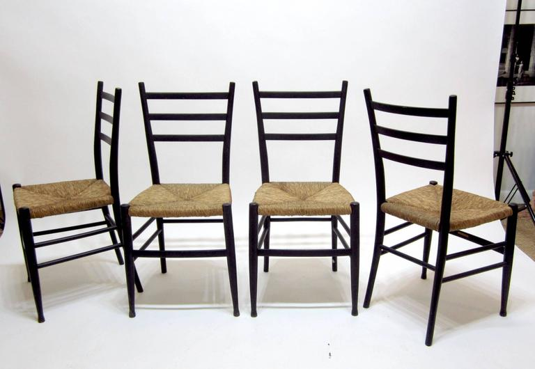 Set Of Four Black Painted Wood Ladder Back Chairs With Rush Seats. The  Seats Are