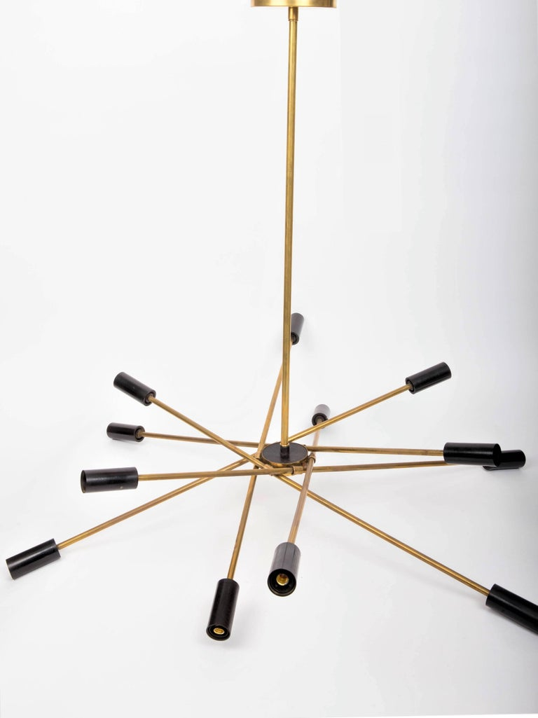 Twelve bulb abstract brass and black Sputnik chandelier, Italy 20th century.
