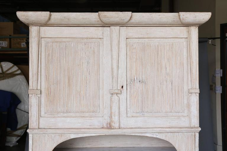 19th century two-piece Swedish painted Folk Art cupboard from Northern Sweden. Beautiful hand channelled detail on doors on the facade. Original paint. Wonderful proportions.