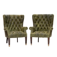 Pair of Tufted Green Leather Wing Chairs