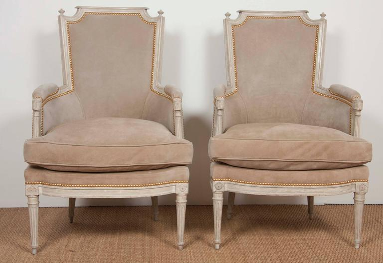 A late 18th-early 19th century pair of Swedish bergere form painted chairs now smoothed and waxed.