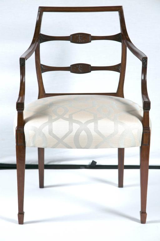 A pair of mahogany George III armchairs with beautiful upholstery.