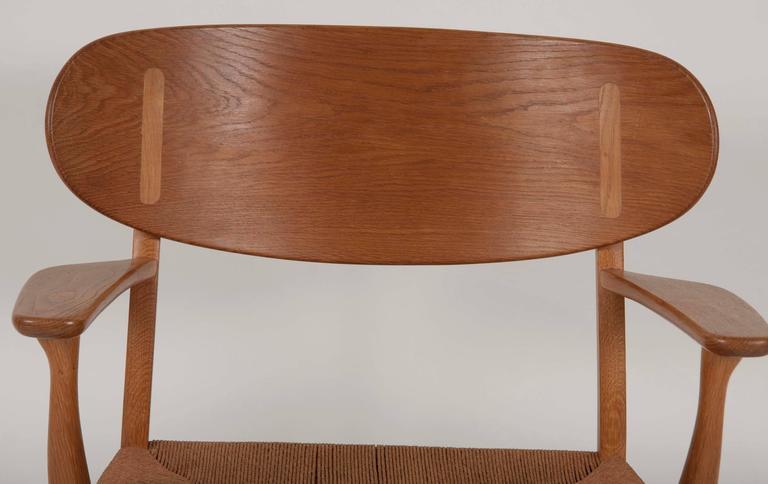 Woodwork Hans Wegner Model CH22 Shell Back Paddle Armchair For Sale