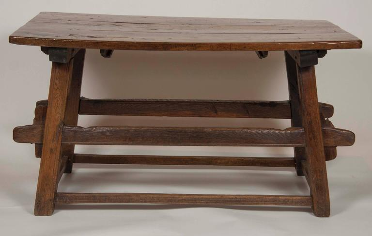 A handsome Continental oak trestle table.