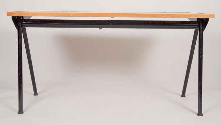 Compass desk design by Jean Prouve in 1953. Produced in 1955 for the Cite Internationale Universitaire. Manufactured by Les Ateliers Jean Prouve, France Literature Anthony DeLorenzo, ed., Jean Prouvé/ Serge Mouille, New York, 1985, p. 65 Peter