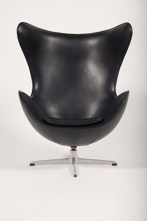 A Mid-Century, leather and chrome armchair designed by Arne Jacobsen and produced by Fritz Hansen. Newly upholstered in Edelman leather.