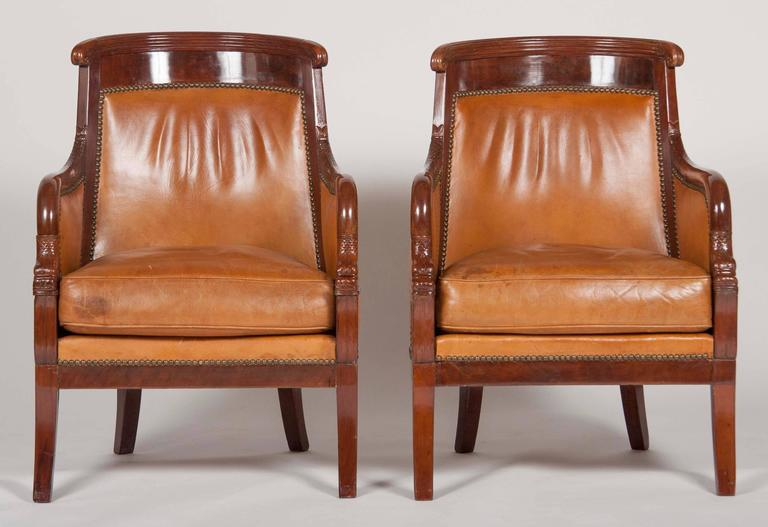 A matched pair of mahogany Louis Philippe bergères upholstered in leather.