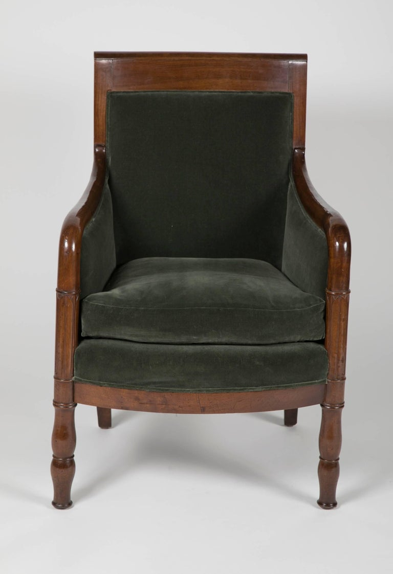 A French mahogany Directoire bergere with velvet upholstery.