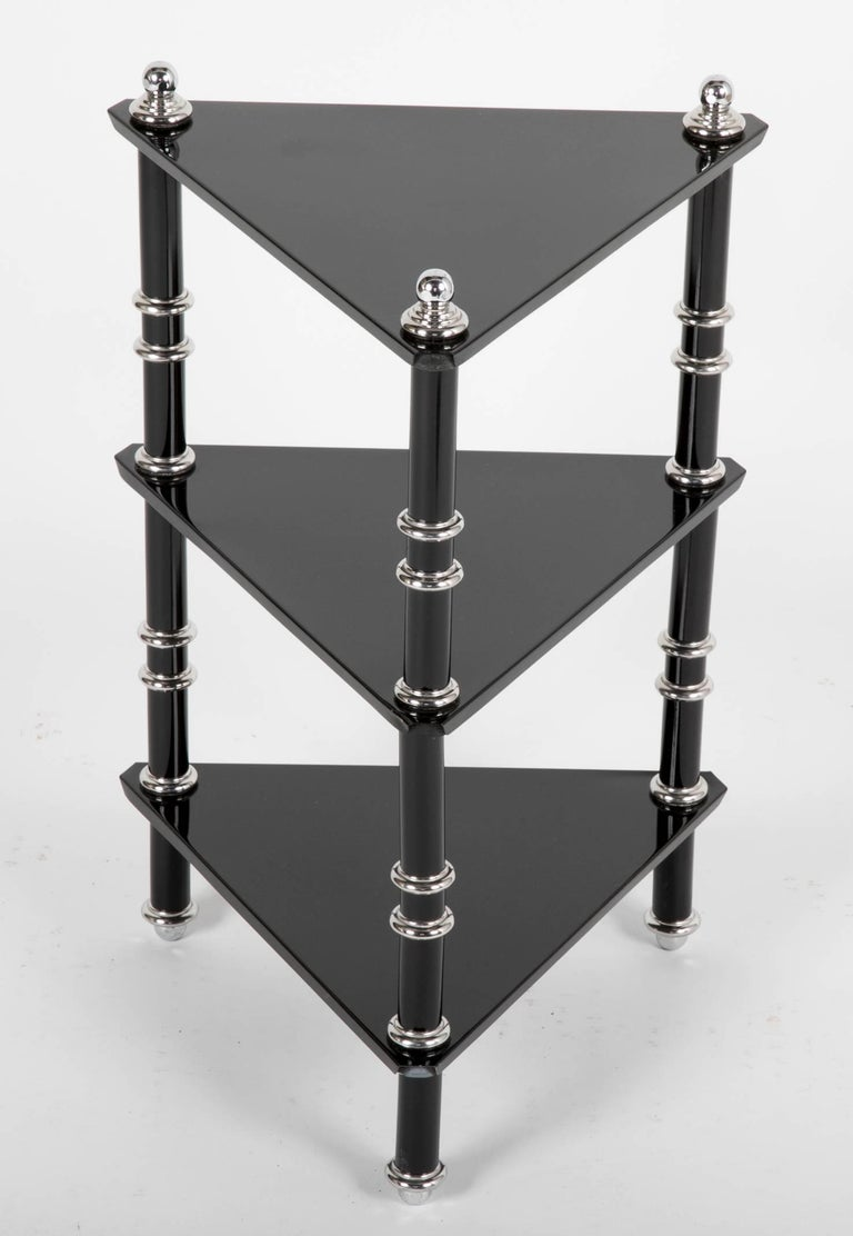 A ebonized and polished Aluminum side table by Warren McArthur. This side table is almost certainly from 1929, showing the prevalence of the triangle in McArthurs work around the time that he did the interior furniture for the Arizona Biltmore.