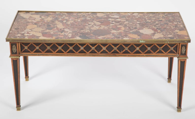 Elegant French Louis XVI style coffee table custom made by Jansen with bronze contour and ornaments, very fine brèche d'Alep marble top and lozenge pattern marquetry    Provenance: documented 998 Fifth Avenue, NY residence.