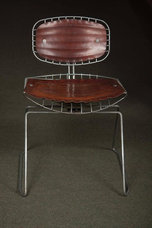 A matched set of eight Michel Cadestin and Georges Laurent leather and metal Beaubourg chairs, from the Centre Georges Pompidou, Paris. These chairs were designed in 1976 for the competition to determine which chairs would be used in the Pompidou