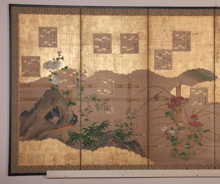 A six-panel Japanese paper screen with poems, autumn flowers, bamboo fence and Mandarin ducks. Poems are believed to be earlier but were probably added.