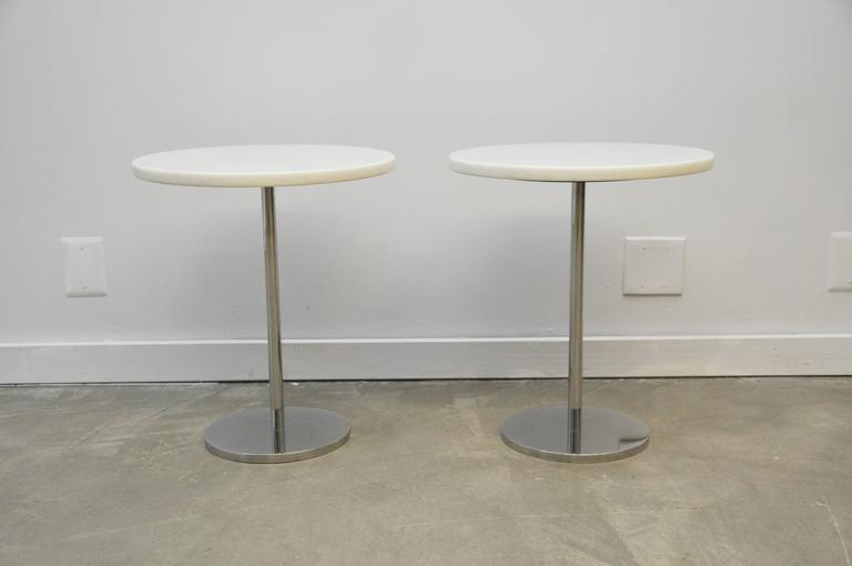Pair of white marble side tables with polished stainless steel bases. Custom produced by Gerald R. Griffith Studio, circa 1970. Very heavy, top quality Minimalist design.