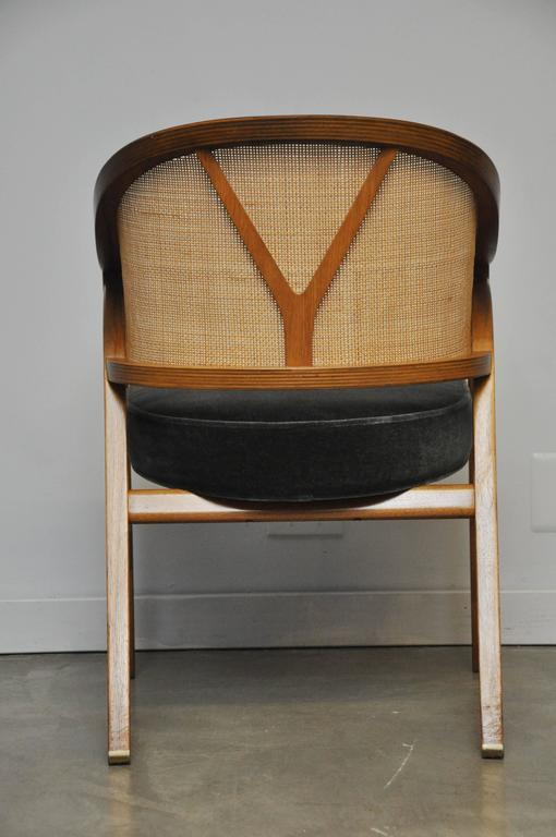 Walnut frame captain chair by Edward Wormley. Cane back with new mohair upholstery.