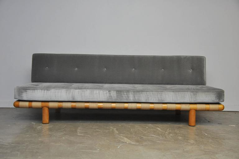 Strapped frame sofa by T.H. Robsjohn-Gibbings. Frame and strapping in very good vintage condition. New foam and ultra plush velvet upholstery.