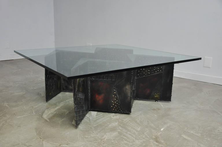 Large double zig zag pedestal coffee table by Paul Evans for Directional. Model PE-11. Sculpted and welded metal patchwork. Bronze patina accented by primary colors. New glass top.