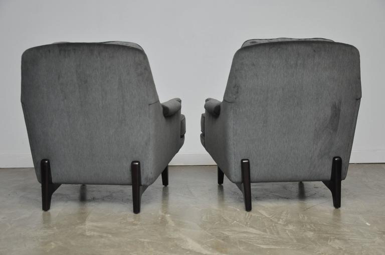 Pair of Dunbar lounge chairs designed by Roger Sprunger for Dunbar. Fully restored. Refinished mahogany bases in Classic espresso tone. New cushions, foam and soft grey velvet. Beautiful form.