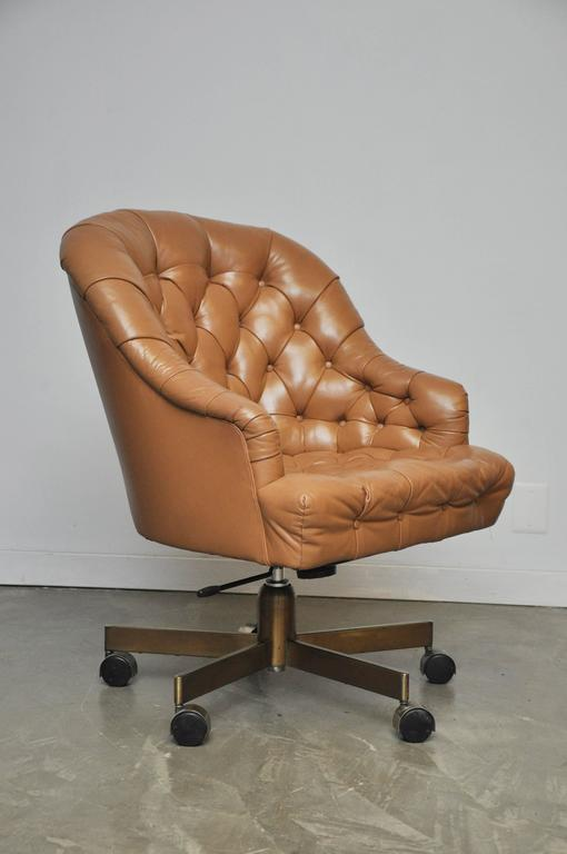 Classic leather Chesterfield tufted executive office chair by Edward Wormey for Dunbar. Original tan leather in excellent condition with bronze base. Adjustable height and tilt.