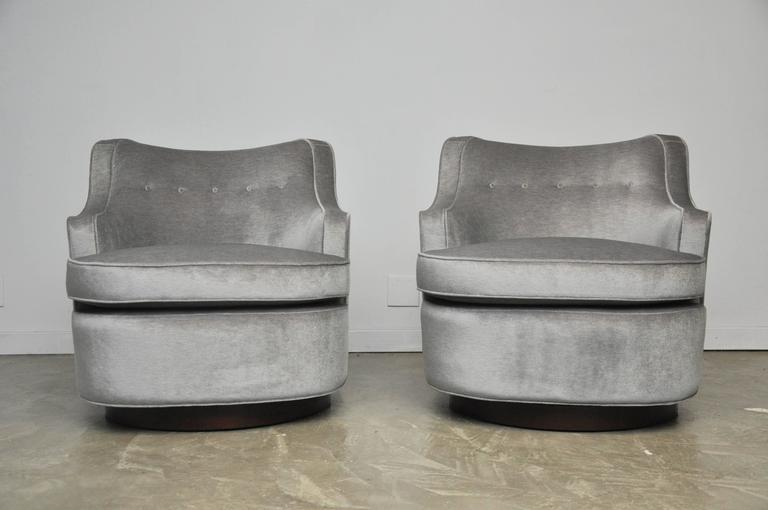 Pair of early design swivel chairs by Edward Wormley for Dunbar. Fully restored mahogony bases with new 100% angora ultra lux mohair.