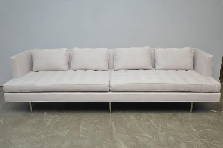 Classic Dunbar sofa designed by Edward Wormley, circa 1950. Fully restored, newer upholstery in woven white fabric over original polished nickel legs.